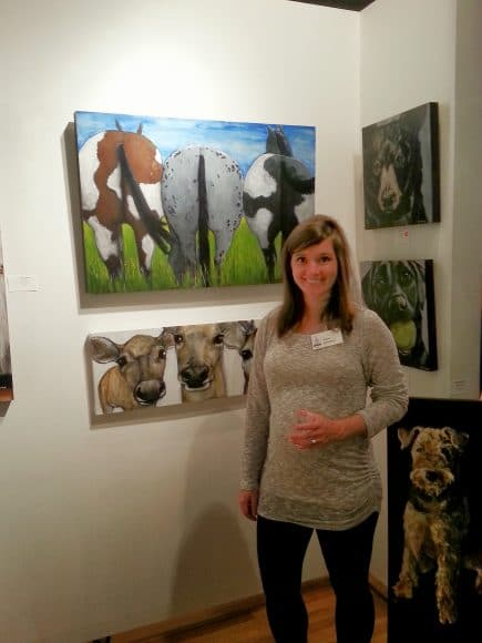 Marietta, Georgia artist Claire Dunaway standing in front of her animal paintings.