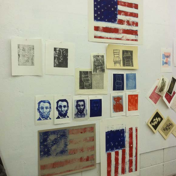 Some of my prints from Day 1 and 2 of the workshop. I printed a backward American Flag. After hours of explaining the backward printmaking deal to my students I committed the crime myself. It's the vertical one hung that way in an attempt to trick your mind.